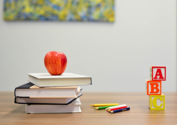 Classroom materials including an apple and blocks