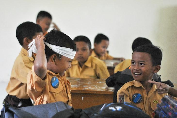 Students in classroom having fun enjoying lesson