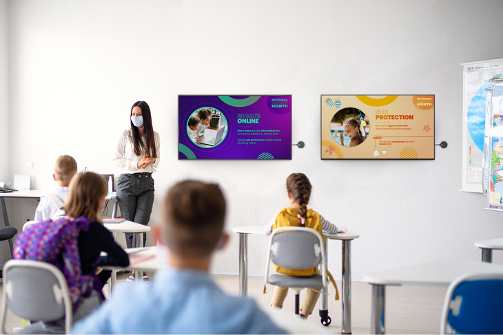 Safety messages showing on Airtame and Rise Vision displays in a classroom