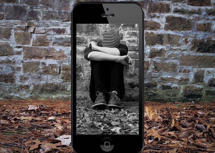 Cyberbullying a student through a phone.