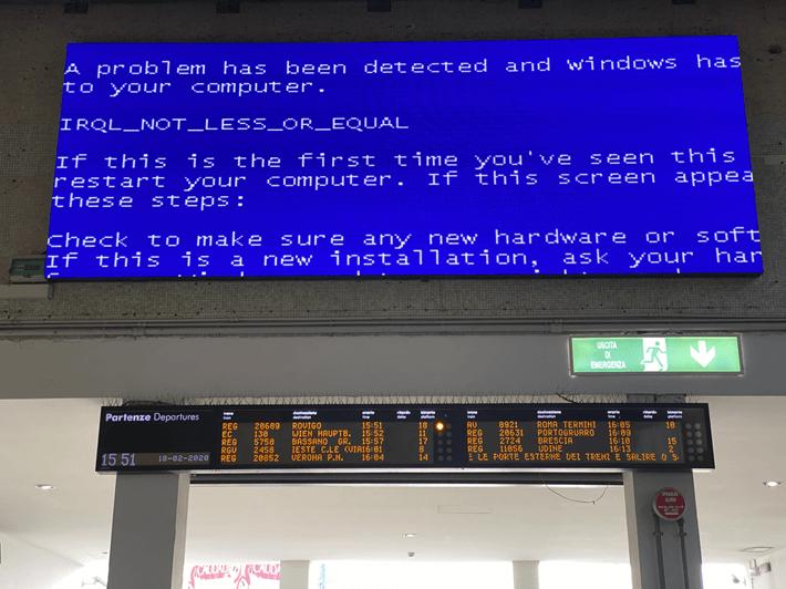 A broken digital sign showing an error message.