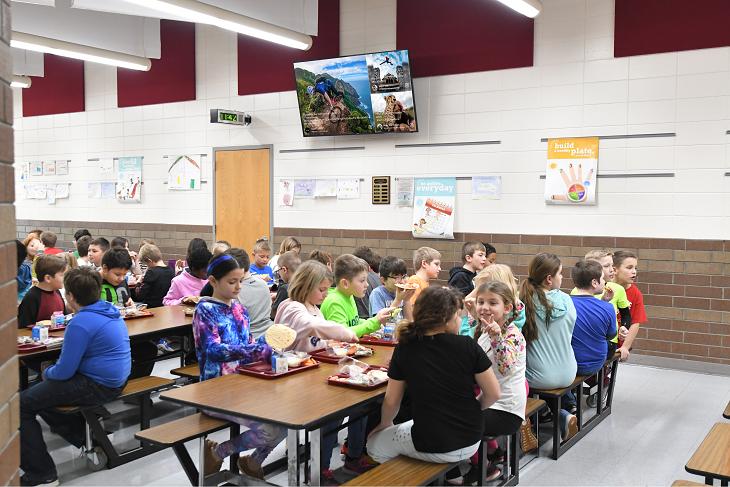 A social media wall in a school cafeteria