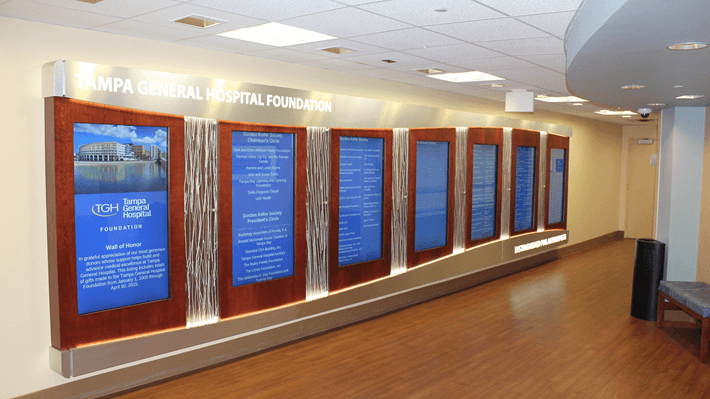 A series of portrait digital signs being used to show a donor wall.