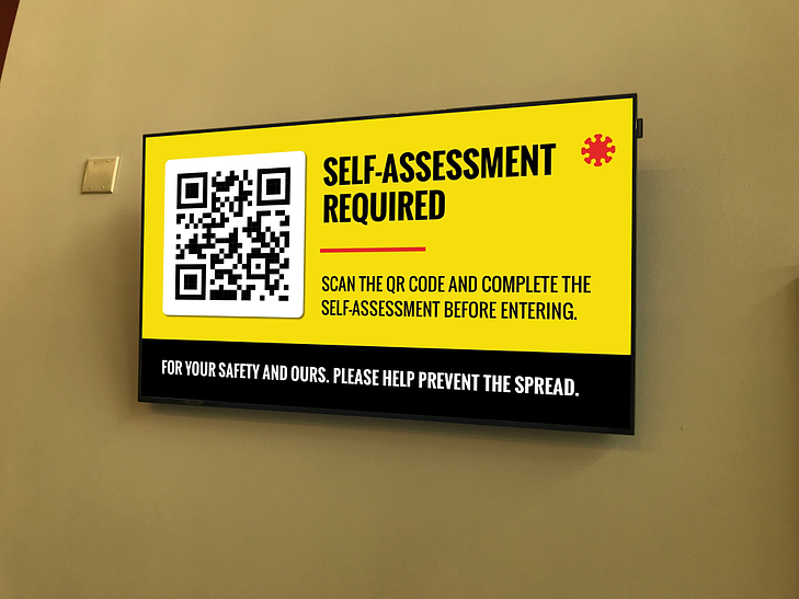 Digital signage explaining that a self-assessment quiz is required before entering.
